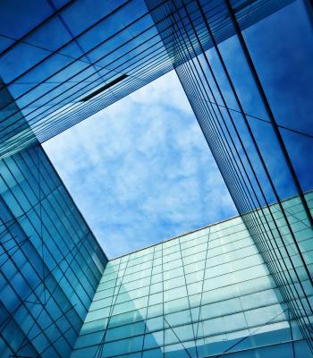 Blue sky through building