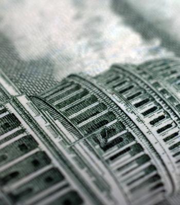 Capital building on dollar bill